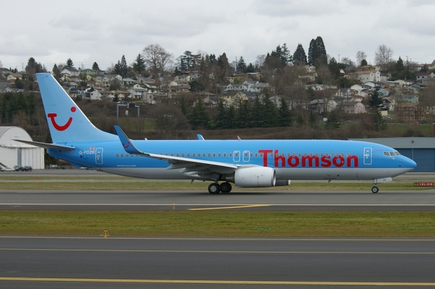 "G-FDZR taxies at Seattle (King County-Boeing Field) in the 2001 TUI ""smile"" livery.  Copyright Photo: Joe G. Walker."