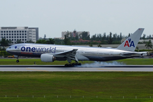 American's Boeing 777-223 ER N791AN (msn 30254) in the Oneworld Alliance livery pounds back to the runway at the Miami hub.  Copyright Photo: Wade DeNero.