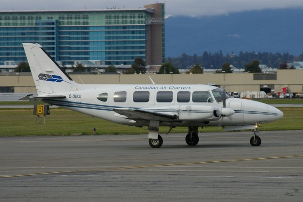 Piper PA-31-350 C-GIKA (msn 31-8052130) of Canadian Air Charters taxies at Vancouver before the crash on July 9, 2009.  Copyright Photo: Joe G. Walker.