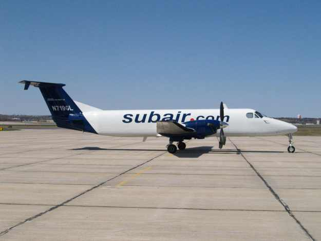 Suburban Air Freight operates under the Subair.com name.  Beech 1900C N719GL rests on the Lincoln ramp before additional Pet Airways sub-titles were added.  Copyright Photo: Gary R. Schenaman.