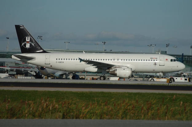 C-GQCA is pictured at Toronto (Pearson) with the U2 logo on the tail.  Copyright Photo: TMK Photography.