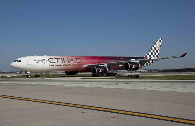 Etihad Airways' Airbus A340-642X A6-EHJ (msn 933) landed at Chicago's O'Hare Airport on September 2, 2009, marking the start of non-stop service from the United Arab Emirates' capital of Abu Dhabi to the Midwest. The aircraft is painted with Formula 1 race car livery to denote Etihad's title sponsorship of the first-ever Abu Dhabi Grand Prix taking place on November 1.  Copyright Photo: Business Wire.