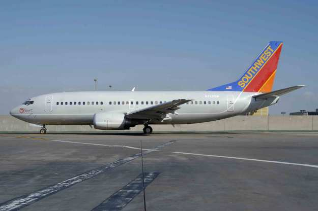 "N629SW prepares to taxi from the gate at Los Angeles in the gray fuselage version of ""Silver One"".  Copyright Photo: Roy Lock."