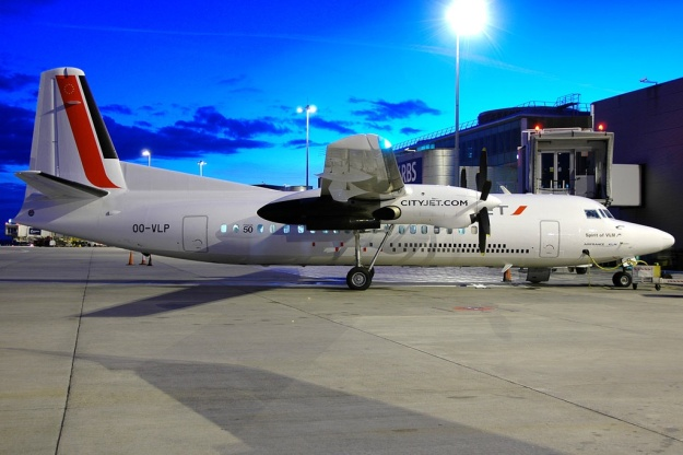 Copyright Photo: Nik French.  VLM's Fokker F.27 Mk. 050 OO-VLP (msn 20209) was previously painted as The Green Machine and before that in the Euro 2008 soccer colors.  It is pictured at Manchester after dark in CityJet's colors.
