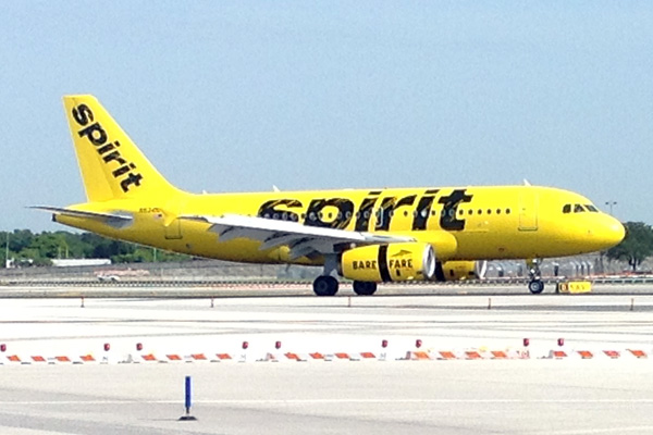 Spirit airlines brings back the yellowbird with its new for Book a flight with spirit airlines
