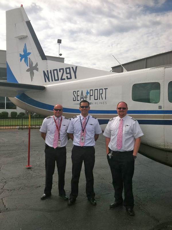 SeaPort C-208B N1029Y (Tail) and Crew (SeaPort)(LR)
