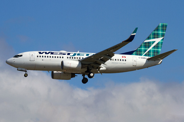 WestJet unveils its new #TartanTail, one of two Boeing Next-Generation 737s with a custom-designed tartan decal to mark the airline's new service between Halifax and Scotland launching May 29, 2015. Photo credit: Andy Cline (CNW Group/WestJet)