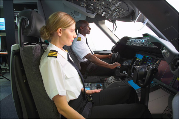 Pilots in Simulator; Pilots on flight deck; Female Co-Pilot; Male African-American Pilot; K66420-03